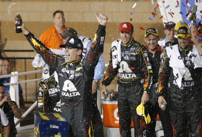 NASCAR driver Jeff Gordon celebrates in victory lane after winning the Sprint Cup Series auto race at Kansas Speedway in Kansas City, Kan., Saturday, May 10, 2014. (AP Photo/Orlin Wagner)