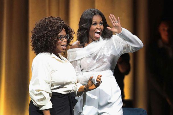 PHOTO: Oprah Winfrey introduces former first lady Michelle Obama as she kicks off her 'Becoming' arena book tour on in Chicago, Nov. 13, 2018. (Scott Olson/Getty Images, FILE)