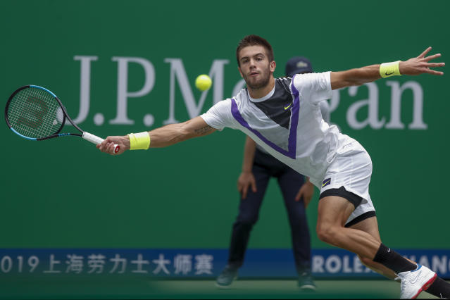 Borna Coric of Croatia reaches for the ball as he plays against Andrey Rublev, of Russia in their men's singles match at the Shanghai Masters tennis tournament at Qizhong Forest Sports City Tennis Center in Shanghai, China Tuesday, Oct. 8, 2019. (AP Photo/Andy Wong)