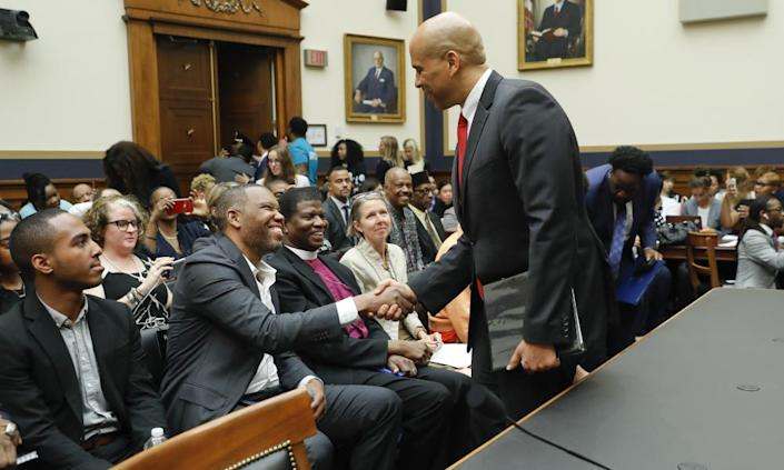 "<span class=""element-image__caption"">Cory Booker, right, with Ta-Nehisi Coates before the hearing.</span> <span class=""element-image__credit"">Photograph: Pablo Martínez Monsiváis/AP</span>"