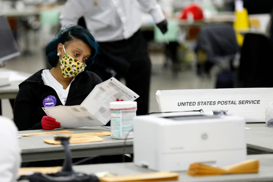Image: Poll counting in Detroit (Jeff Kowalsky / AFP - Getty Images)