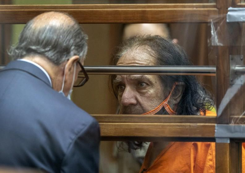 Adult film star Ron Jeremy talks with his attorney Stuart Goldfarb during his arraignment on rape and sexual assault charges at Clara Shortridge Foltz Criminal Justice Center, Friday, June 26, 2020, in Los Angeles. Jeremy pleaded not guilty to charges of raping three women and sexually assaulting a fourth. (David McNew/Pool Photo via AP)