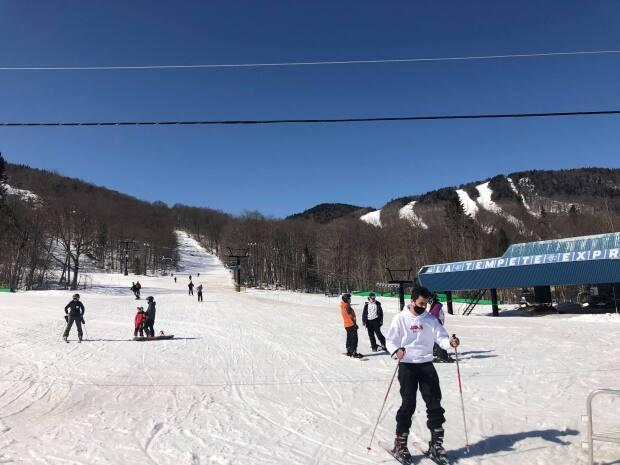 Skiers enjoy spring conditions on the slopes of Stoneham Mountain Resort. With public health measures limiting attendance at resorts, season passes were attractive to some this season because they offered guaranteed access to the mountain. (Jean-Philippe Martin/Radio-Canada - image credit)