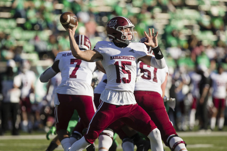 UMass quarterback Will Koch (15) attempts a pass as the Minutemen take on Marshall during an NCAA football game on Saturday, Nov. 7, 2020, at Joan C. Edwards Stadium in Huntington, W.Va. (Sholten Singer/The Herald-Dispatch via AP)