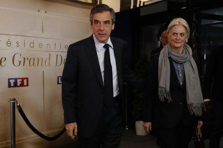 Francois Fillon and his wife Penelope arrive for a debate organised by French private TV channel TF1 in Aubervilliers