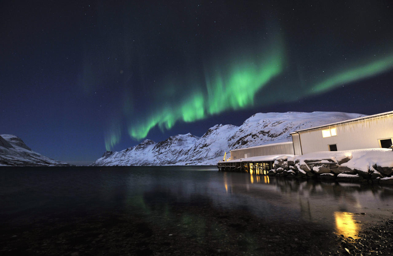 In this photo taken Sunday, Feb. 13, 2011, the aurora borealis, or northern lights, light up the sky above the village of Ersfjordbotn, near Tromso, northern Norway. (AP Photo/Keystone, Martial Trezzini) NO SALES, NO ARCHIVE