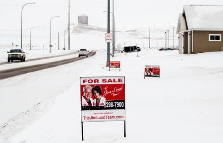 FILE PHOTO:  A sign advertises homes for sale in a new housing development in Dickinson, North Dakota January 21, 2016. REUTERS/Andrew Cullen