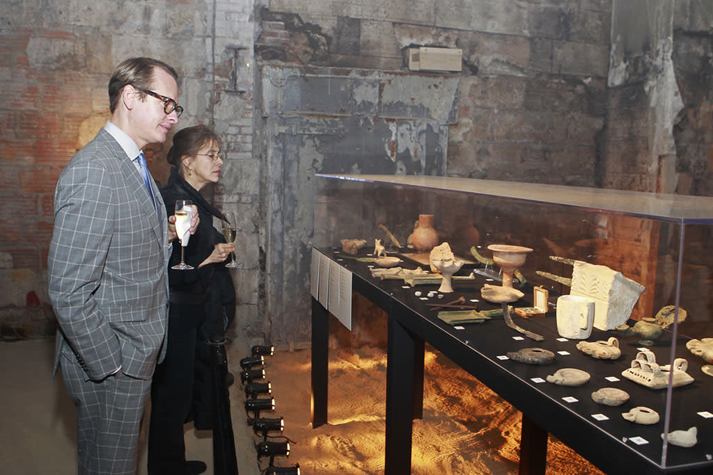 "Carson Kressley  views one of the exhibits at the ""The Bible Experience"" opening night gala, a rare exhibit of biblical artifacts on Tuesday, March 19 in New York."