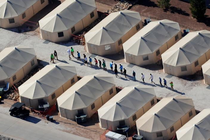 Immigrant children shown walking in single file at the Tornillo, Texas, tent city on June 19, 2018. (Photo: Mike Blake/Reuters)