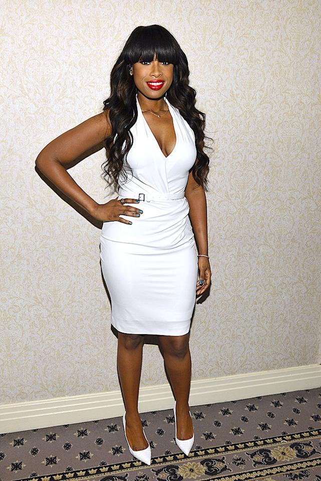 Forget the ridiculous fashion rule that states one can't wear white after Labor Day. These days, winter white is considered incredibly chic as evidenced by a number of stars who've incorporated the color into their wardrobes prior to spring. Pushing the envelope even further -- at Thursday night's Amy Winehouse Inspiration Awards -- was singer/actress Jennifer Hudson, who dared to pair a belted halterneck dress (complete with plunging neckline) with a pair of matching pumps. A few of you may consider this ensemble worthy of an appearance in our What Were They Thinking?! gallery, but we happen to think JHud looks 2 Hot 2 Handle! (3/21/2013)