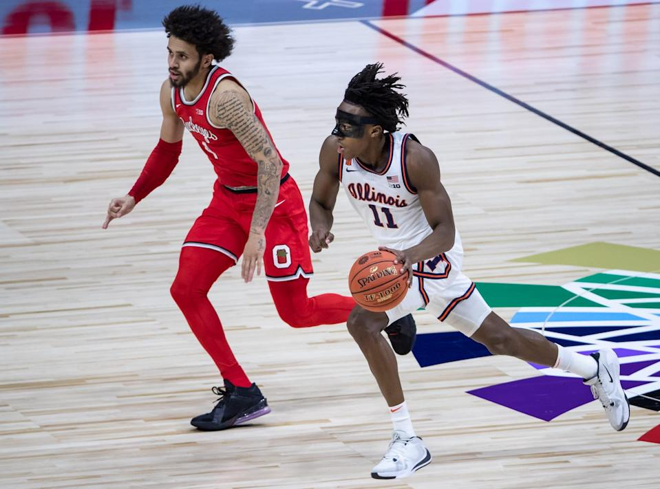 Illinois Fighting Illini guard Ayo Dosunmu (11) drives the ball quickly down the court during the Big Ten Tournament title game Sunday, March 14, 2021, at Lucas Oil Stadium in Indianapolis. (Via OlyDrop)