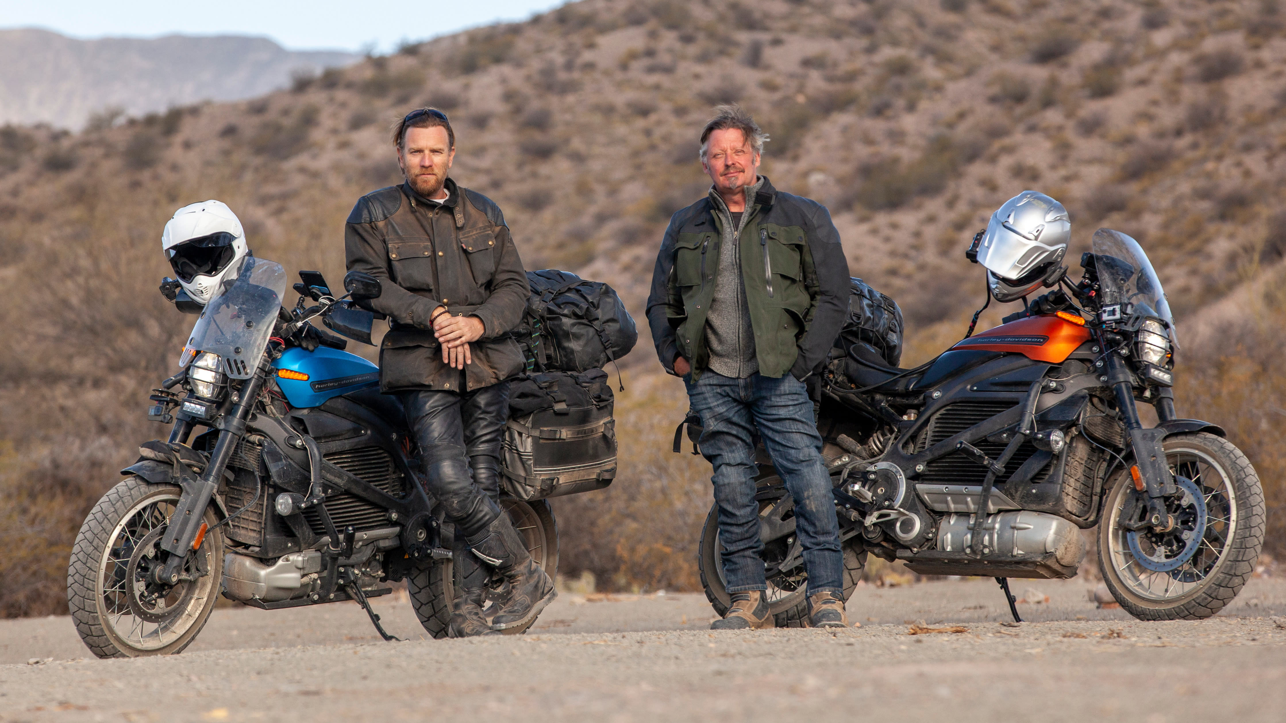 Ewan McGregor and Charley Boorman get on their bikes in 'Long Way Up'. (Credit: Apple TV+)
