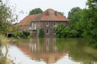 High water is seen near a house, in Roermond