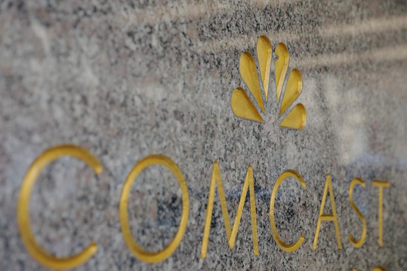 FILE PHOTO: The NBC and Comcast logos are displayed on 30 Rockefeller Plaza in midtown Manhattan in New York, U.S., February 27, 2018.  REUTERS/Lucas Jackson/File Photo