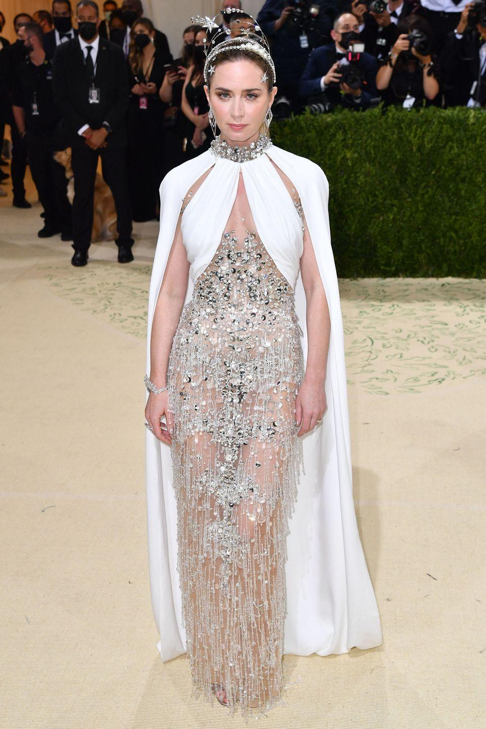 <p>Emily Blunt wore a Miu Miu glass raindrop shape beaded dress and headpiece, inspired by the Statue of Liberty. </p>