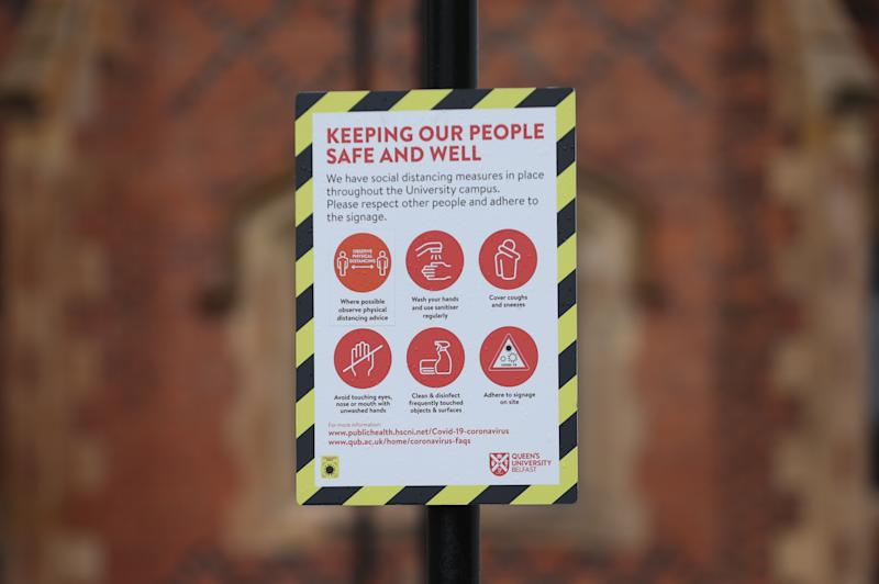 A sign outside Queen's University in Belfast. Stormont finance minister Mr Murphy said there was a need to confirm what level of support the UK Government would offer if another lockdown was required. (Photo by Liam McBurney/PA Images via Getty Images)