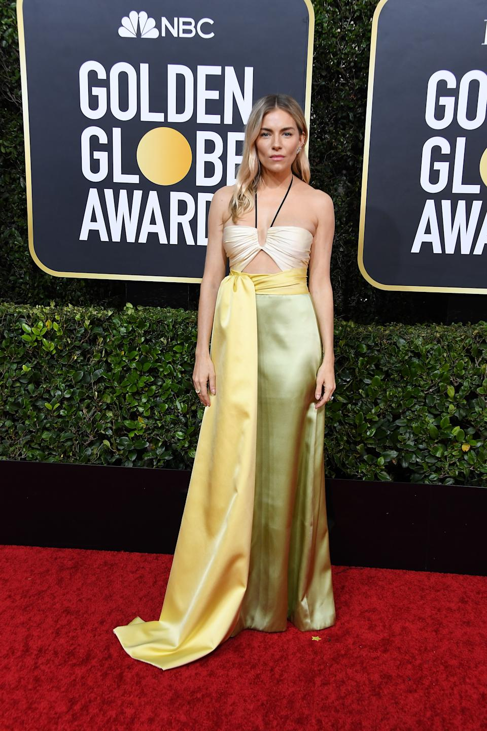 Miller opted for a summery lime and yellow gown by Gucci. (Photo by Steve Granitz/WireImage)