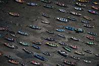 <p>In this July 5, 2016 photo, boats sit on the polluted shore of Guanabara Bay in the Sao Goncalo suburb across the bay from Rio de Janeiro, Brazil. In Rio, the main tourist gateway to the country, a centuries-long sewage problem that was part of Brazil's colonial legacy has spiked in recent decades in tandem with the rural exodus that saw the metropolitan area nearly double in size since 1970. (AP Photo/Felipe Dana)</p>