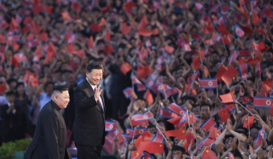 North Korean leader Kim Jong-un (left) and Chinese President Xi Jinping attend a mass gymnastic performance at the May Day Stadium in Pyongyang, North Korea, last week. Photo: Xinhua