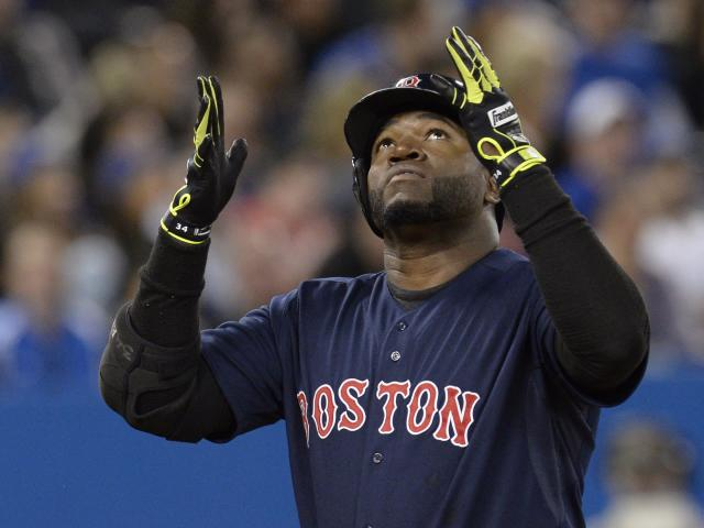 Boston Red Sox's David Ortiz celebrates his solo home run as he crosses the plate during the third inning of a baseball game against the Toronto Blue Jays in Toronto on Friday, April 25, 2014. (AP Photo/The Canadian Press, Frank Gunn)