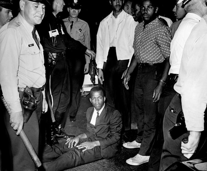 Protests continued leading up to the March on Washington in Aug. 1963. Lewis sits in the street, in protest of Nashville police arresting Lamar Richardson, a Fisk University student. The group was having a sit-in demonstration in front of the B & W Cafeteria.