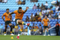 Australia's Quade Cooper attempts a penalty kick against Argentina during their Rugby Championship test match on the Gold Coast, Australia, Saturday, Oct. 2, 2021. (AP Photo/Tertius Pickard)