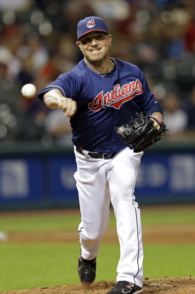 Cleveland Indians relief pitcher Joe Smith throws to first to pick off New York Mets' Eric Young Jr. in the eighth inning of a baseball game Friday, Sept. 6, 2013, in Cleveland. (AP Photo/Mark Duncan)