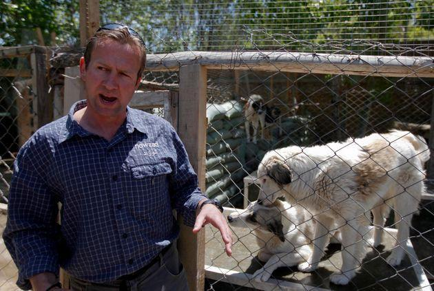 Pen Farthing, founder of British charity Nowzad, an animal shelter, stands in front of a cage on the outskirts of Kabul May 1, 2012 (Photo: Omar Sobhani via Reuters)
