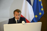 French President Emmanuel Macron speaks during a video-conference on the situation in Lebanon from Fort de Bregançon, southern France, Sunday Aug. 9, 2020. French President Emmanuel Macron's organized an international conference on Sunday aiming at bringing donors together to provide emergency aid and equipment to the Lebanese population. ( Christophe Simon, Pool via AP)