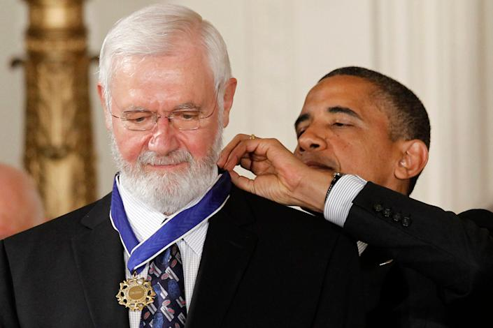 President Barack Obama awards the Medal of Freedom to William Foege, former director of the Centers for Disease Control and Prevention, who helped lead the effort to eradicate smallpox, during a ceremony in the East Room of the White House in Washington, Tuesday, May 29, 2012.