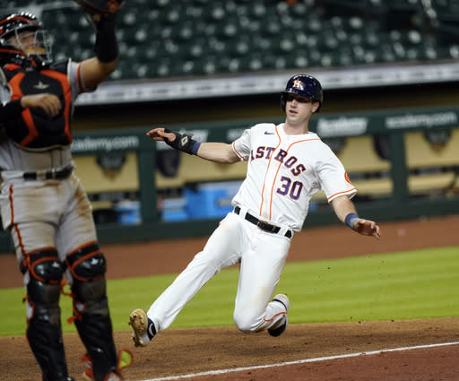 Houston Astros' Kyle Tucker (30) scores as San Francisco Giants catcher Chadwick Tromp handles the throw during the sixth inning of a baseball game Tuesday, Aug. 11, 2020, in Houston. (AP Photo/David J. Phillip)