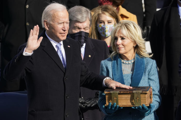 "FILE - In this Wednesday, Jan. 20, 2021 file photo, Joe Biden is sworn in as the 46th president of the United States by Chief Justice John Roberts as Jill Biden holds the Bible during the 59th Presidential Inauguration at the U.S. Capitol in Washington. On Friday, Jan. 29, 2021, The Associated Press reported on stories circulating online incorrectly asserting Biden swore on a ""Masonic/Illuminati"" Bible during his inauguration. It is a Douay-Rheims Bible, an English translation of a Latin Bible, which has been in the Biden family since the 1890s. Robert Miller, professor of biblical studies at The Catholic University of America, says, ""Nothing even vaguely Masonic would have been anywhere near these Bibles. … Same thing for the 'Illuminati,' to the extent that such a thing existed: repeatedly condemned by the Popes and certainly coming nowhere into contact with Catholic Bibles."" (AP Photo/Andrew Harnik)"