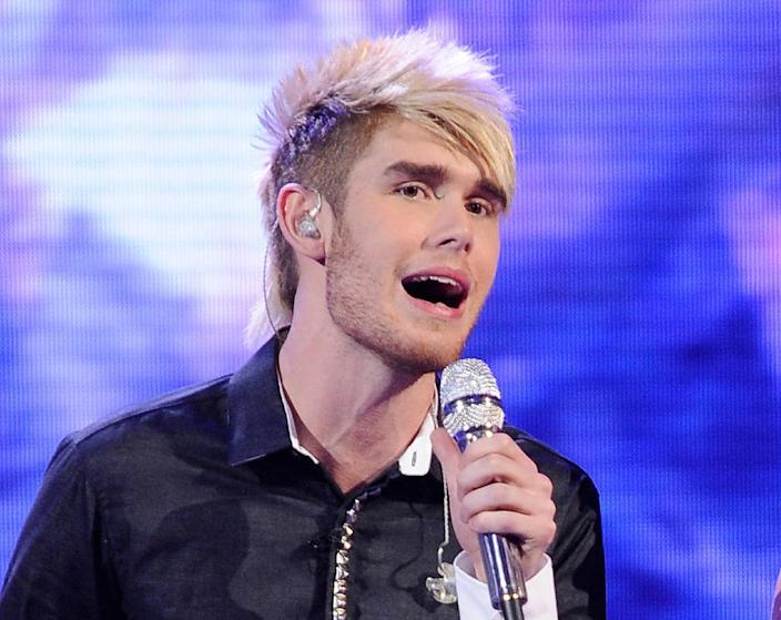"""FILE - In this April 11, 2012 file photo released by Fox, Colton Dixon performs on the singing competition series """"American Idol,"""" in Los Angeles. The 20-year-old alt-rocker was revealed Thursday, April 19, 2012 to have received the fewest viewer votes on the Fox talent competition. Dixon was surprisingly eliminated from """"Idol"""" after delivering lukewarm renditions of Lady Gaga's """"Bad Romance"""" and Earth Wind and Fire's """"September"""" on Wednesday's evening of old and new tunes. (AP Photo/Fox, Michael Becker, File)"""