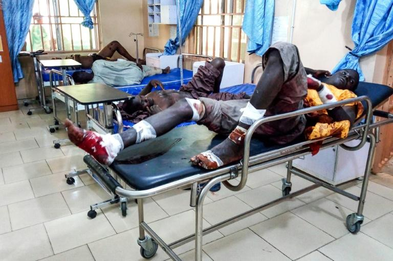 Injured men in hospital after a suicide bomber attack in northeastern Nigeria