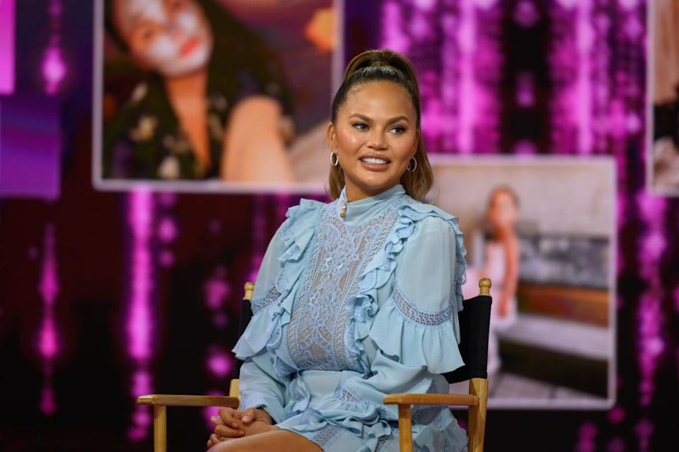 Chrissy Teigen has opened up about the anxiety she's been feeling in early pregnancy, pictured in February 2020 (Getty Images)