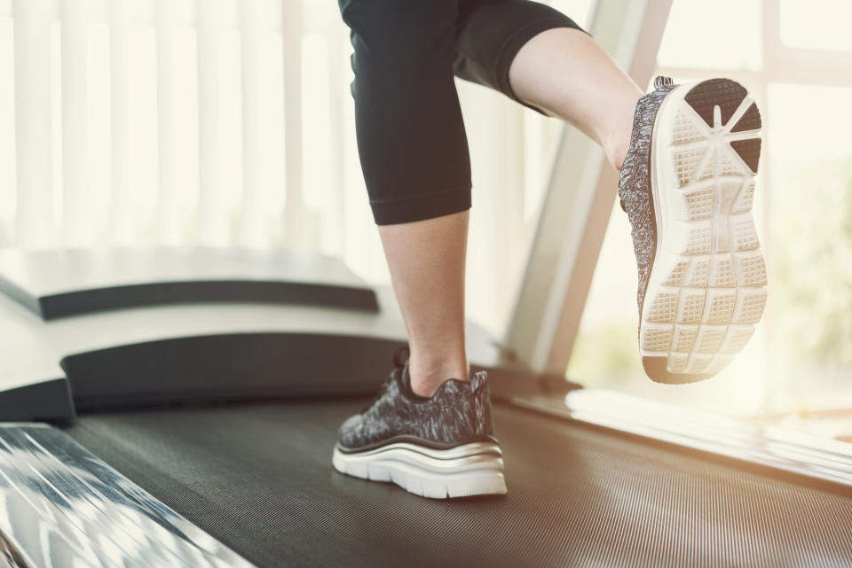 A woman running on a treadmill. (PHOTO: Getty Images)