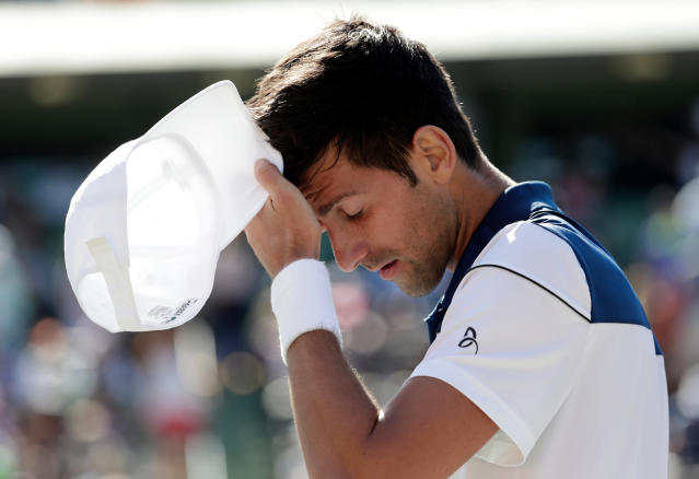 FILE - In this March 23, 2018, file photo, Novak Djokovic, of Serbia, walks to his chair during his match against Benoit Paire, of France, at the Miami Open tennis tournament in Key Biscayne, Fla. Djokovic has split with Andre Agassi and Radek Stepanek in the latest in a series of coaching changes for the 12-time major champion. Djokovic announced the moves Wednesday, April 4, 2018, on his website. (AP Photo/Lynne Sladky, File)