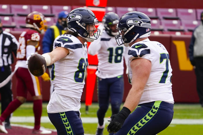 Seattle Seahawks tight end Jacob Hollister (86) celebrating his touchdown with teammate Seattle Seahawks center Ethan Pocic (77) during the first half of an NFL football game against the Washington Football Team, Sunday, Dec. 20, 2020, in Landover, Md. (AP Photo/Andrew Harnik)