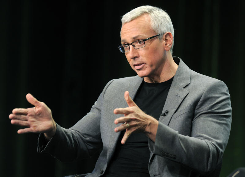 "FILE - This Aug. 4, 2011 file photo shows Dr. Drew Pinsky, host of the CW television series ""Dr. Drew's Lifechangers,"" during a panel discussion on the show at the CW Showtime summer press tour in Beverly Hills, Calif.  Criticism of Dr. Drew Pinsky spread on the Internet almost as quickly as news of Mindy McCready's death. The country singer with the tumultuous personal life became the fifth cast member of his ""Celebrity Rehab"" series to die since appearing on the show and the third from Season 3. (AP Photo/Chris Pizzello, file)"