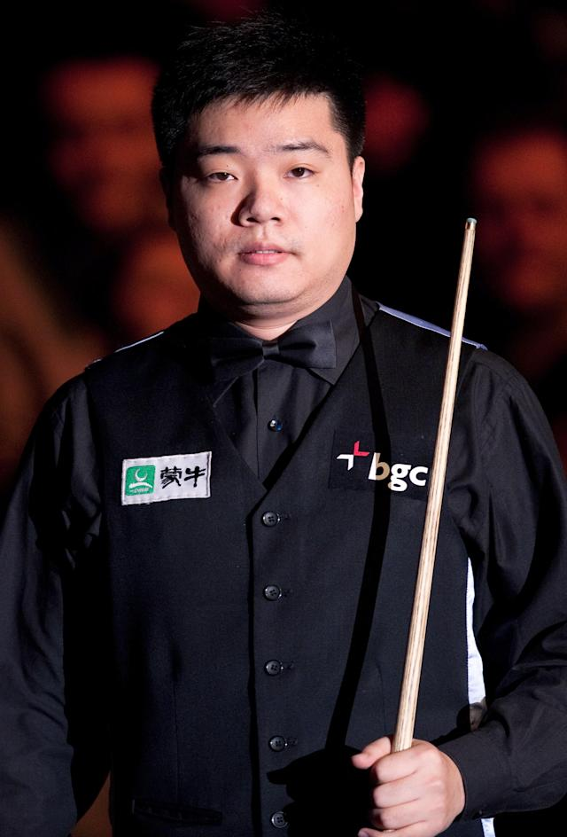 Ding Junhui of China prepares to play against Ronnie O'Sullivan of England during the first round match in the BGC Masters snooker tournament at Alexandra Palace in north London on January 15, 2012. AFP PHOTO / LEON NEAL (Photo credit should read LEON NEAL/AFP/Getty Images)