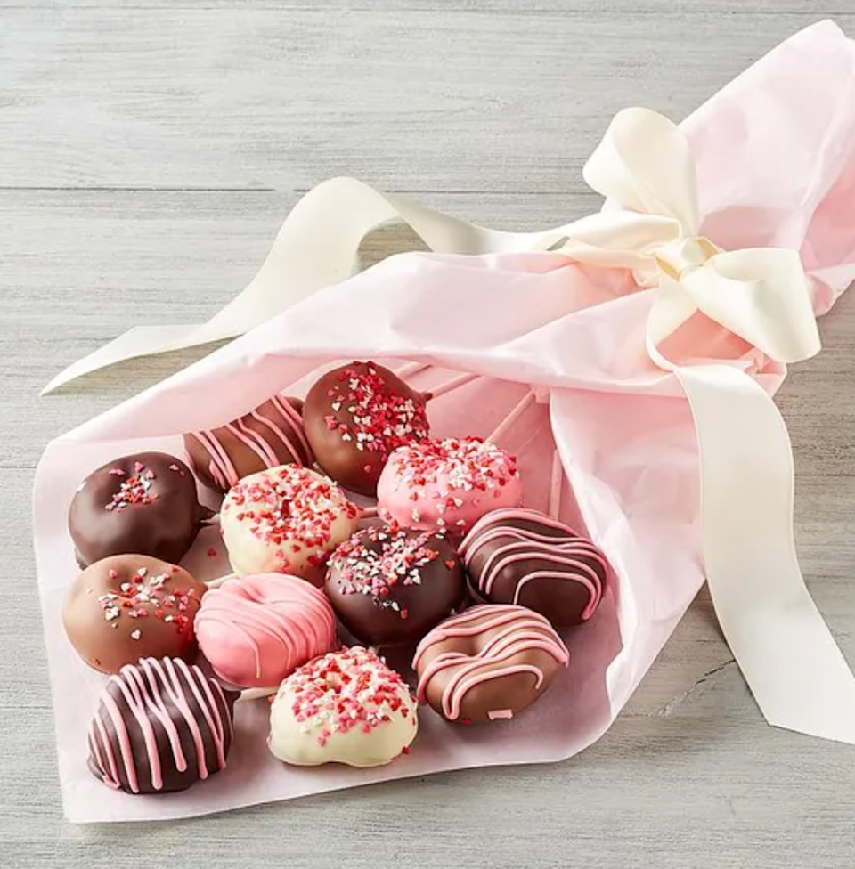 """<strong><h3>Donut Bouquet</h3></strong><br>What's better than a box of donuts? A bouquet of donuts. This pretty pink arrangement features a lineup of ten chocolate-dipped, drizzled, and sprinkled minis.<br><br><strong>Harry & David</strong> Donut Bouquet, $, available at <a href=""""https://go.skimresources.com/?id=30283X879131&url=https%3A%2F%2Fwww.harryanddavid.com%2Fh%2Fbakery%2Fbread-pastries%2F34464"""" rel=""""nofollow noopener"""" target=""""_blank"""" data-ylk=""""slk:Harry & David"""" class=""""link rapid-noclick-resp"""">Harry & David</a>"""