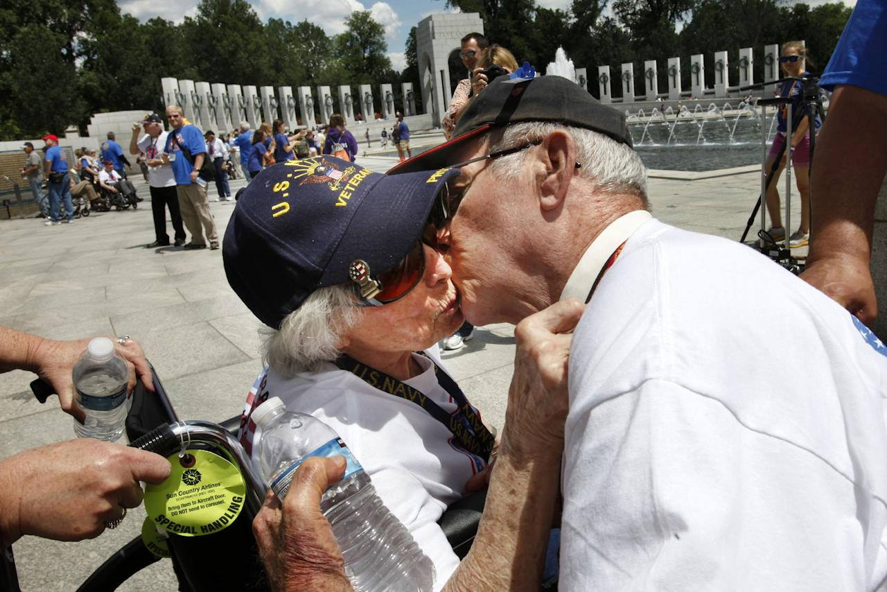 WWII Navy veteran Josephine Bussard, 89, left, and her husband WWII Marine Corps veteran Murray Bussard, 88, of Springfield, Mo., who will have been married 67 years this Friday and met during the war, kiss during a visit to the World War II Memorial in Washington, Wednesday, June 6, 2012, on the 68th anniversary of D-Day. (AP Photo/Jacquelyn Martin)