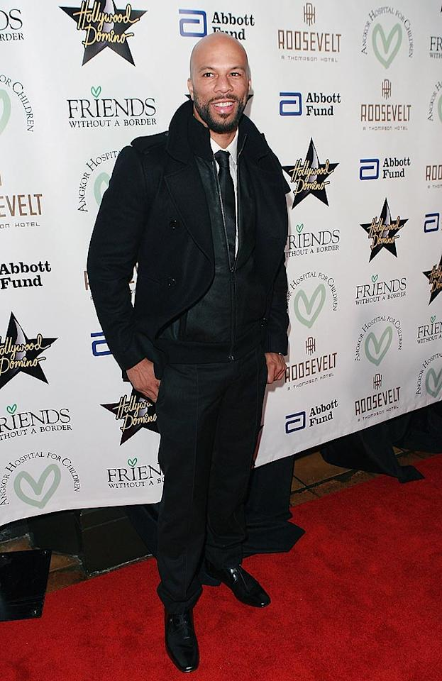 "Now here's a man who knows how to dress for a red carpet event. The only problem? Common could be mistaken for one of the valets with that layered jacket look. Jesse Grant/<a href=""http://www.wireimage.com"" target=""new"">WireImage.com</a> - December 1, 2009"
