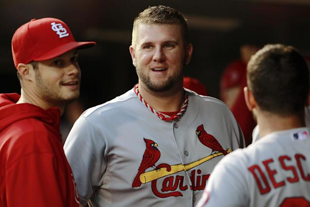 St. Louis Cardinals first baseman Matt Adams, center, jokes with Joe Kelly, left, and Daniel Descalso before facing the Colorado Rockies in the first inning of a baseball game in Denver on Wednesday, Sept. 18, 2013. (AP Photo/David Zalubowski)