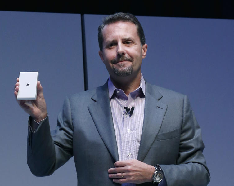 Sony Computer Entertainment President and Group CEO Andrew House holds a PSVita TV during an event in Tokyo, Monday, Sept. 9, 2013. Sony's PSVita TV, which is sold at 9,480 yen ($90) in Japan, is a small device that attaches to a TV set to enjoy music, TV shows, movies and karaoke. (AP Photo/Koji Sasahara)