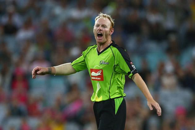 Scott Coyte of the Thunder looks dejected after dropping a catch in the second last over during the Big Bash League match between Sydney Thunder and the Sydney Sixers at ANZ Stadium on December 30, 2012 in Sydney, Australia.  (Photo by Mark Kolbe/Getty Images)