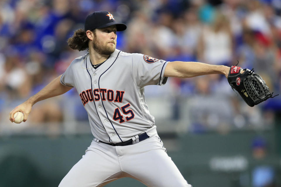 Houston Astros starting pitcher Gerrit Cole delivers to a Kansas City Royals batter during the first inning of a baseball game at Kauffman Stadium in Kansas City, Mo., Friday, Sept. 13, 2019. (AP Photo/Orlin Wagner)