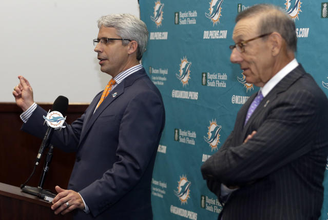 Dennis Hickey, left, the new general manager for the Miami Dolphins NFL football team, speaks after being introduced during a news conference by team owner Stephen Ross, right, Tuesday, Jan. 28, 2014, in Davie, Fla. (AP Photo/Lynne Sladky)
