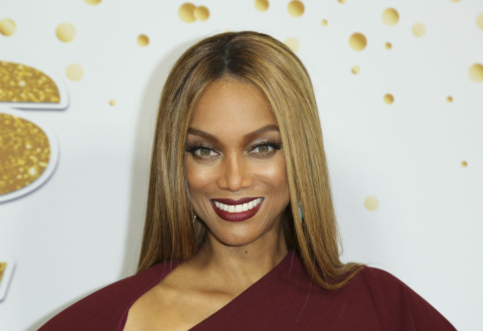 """FILE - In this Tuesday, Aug. 21, 2018, file photo, Tyra Banks attends the """"America's Got Talent"""" Season 13 Week 2 live show at the Dolby Theatre in Los Angeles. Banks will be showing off her moves as solo host of ABC's """"Dancing With the Stars."""" ABC said Wednesday, July 15, 2020, that Banks will replace longtime host Tom Bergeron and take on the role of executive producer for the celebrity dance contest. (Photo by Willy Sanjuan/Invision/AP, File)"""
