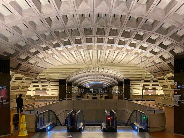 PHOTO: One person walks through the nearly empty Metro Center metro station on April 15, 2020, in Washington, D.C. (Daniel Slim/AFP via Getty Images)